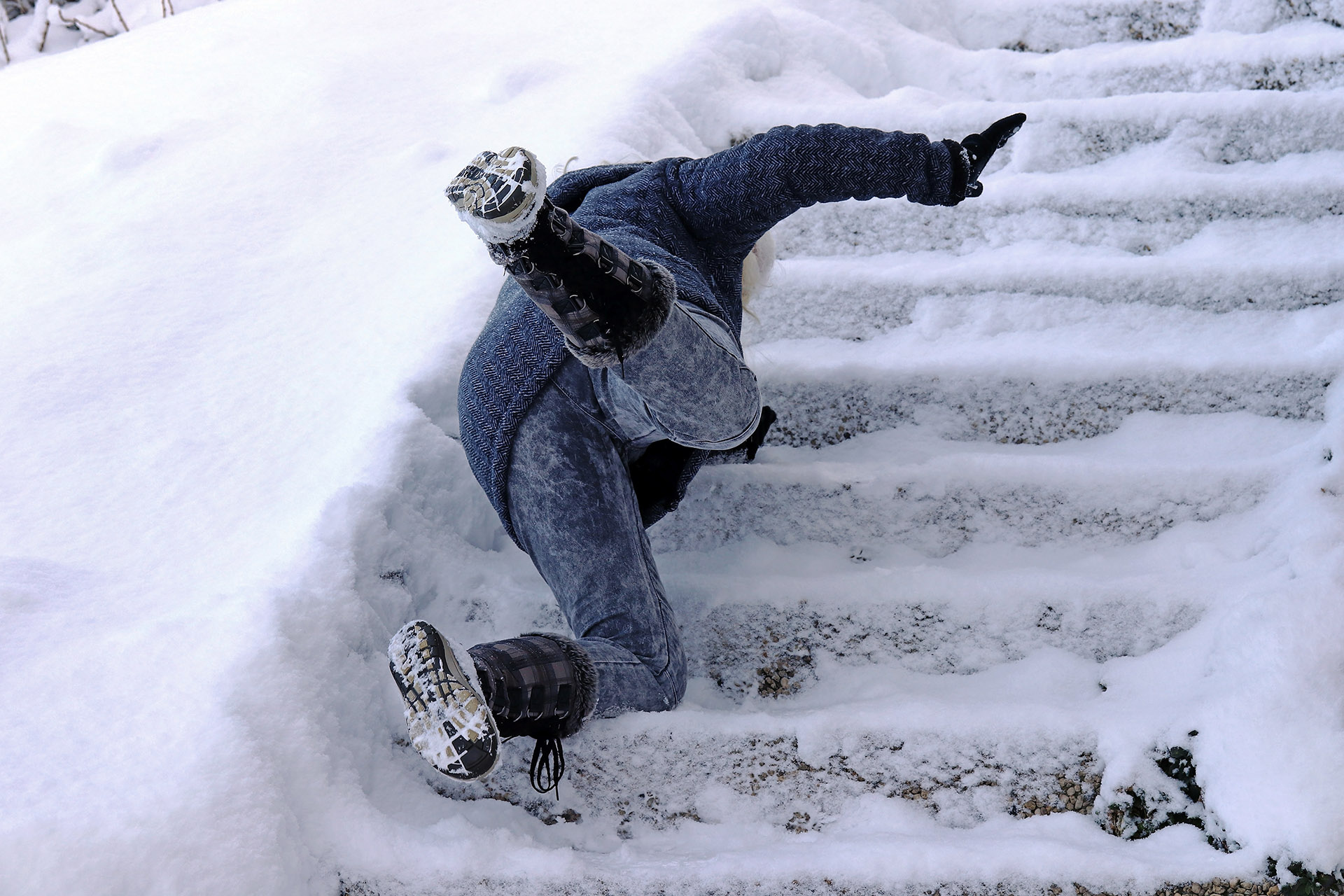 Person Suffering Slip and Fall Upon Icy Stairs