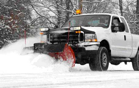 Pickup Truck With Snowplow Plowing Parking Area